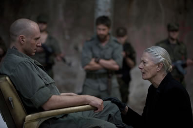 Volumnia kneels before Coriolanus
