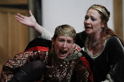 Production picture of Margaret shouting at a crying Henry
