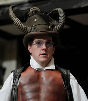 John Harrell as Lucifer in ram horns, breast plate and sunglasses