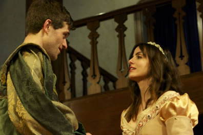 Bassanio in green renaissaince jacket with gold brocade, Portia in a gold, jewell-trimmed dress