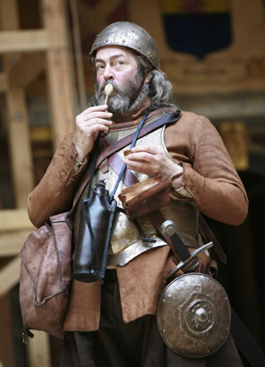 Falstaff in medieval battle gear licks a spoon of ice cream