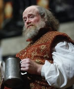 James Keegan as Falstaff holding a tankard in Henry IV, Part 1
