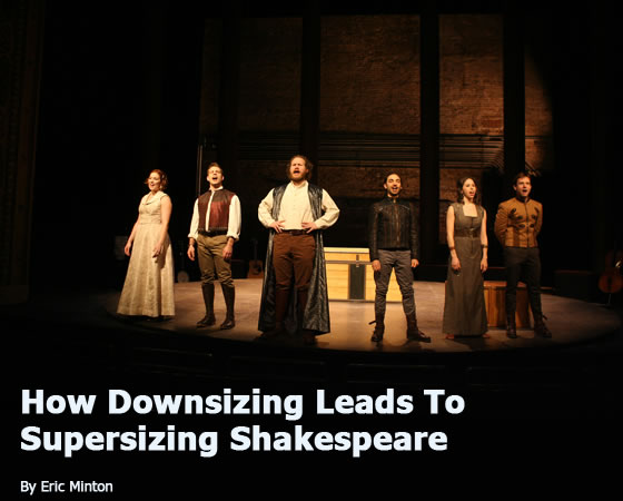 "The six Fiasco players in a spotlight and wearing old-style gowns, britches, vests and coats lined up and singing, with the trunk in the background. ""How Downsizing Leads To Supersizing Shakespeare by Eric Minton"""