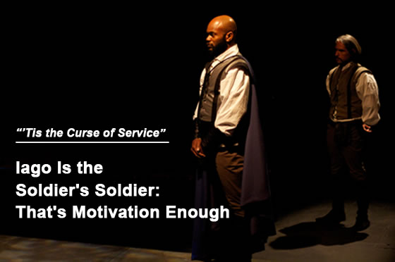 "Photo of Othello standing proud  in cape, and behind to his right is Iago, standing at parade rest in the shadows: headline ""Tis the curse of service: Iago is the Soldier's Soldier: That's Motivation Enough"""