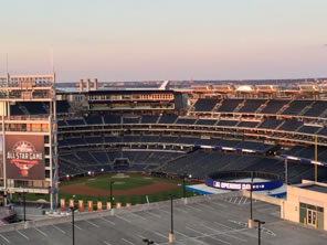 Photo of Nationals Park, with logo of All Star Game and sign flashing Opening Day