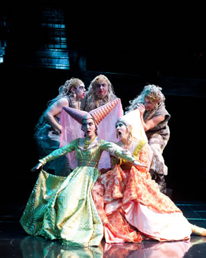 The three Weird Sisters in rags above and behind the two Stepsisters in bright gowns and pointy hats.
