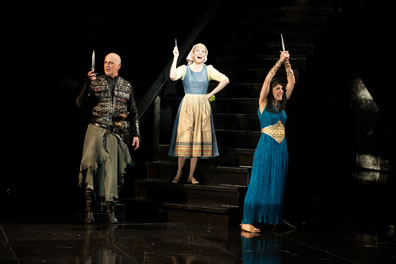 The three leads hold up daggers (paring knife for Cinderella)