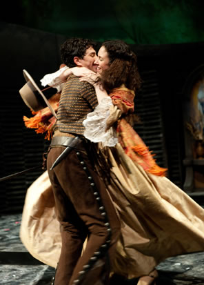 Romeo picks up Juliet in a swirling hug.