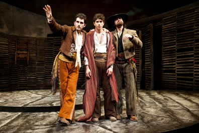 Dressed in rancho vaquero outfits, Benvolio and Mercutio flank a despondend Romeo.