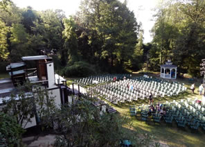 Photo from above of theater and seats in meadow among trees