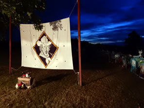Photo of banner with Shakespeare at Winedale logo with sunset behind