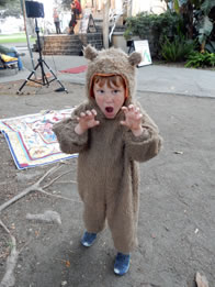 Photo of boy in bear suit growling