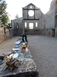 Photo of church ruins wall set up as a bar
