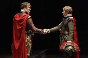 Production pic of Brutus and Cassius shaking hands