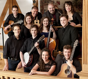 A group portrait of the tour actors, with their musical instruments: guitar, banjo, cello, flute
