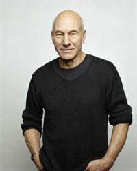 Patrick Stewart, dark sweater shirt with long sleeves rolled up to elbows
